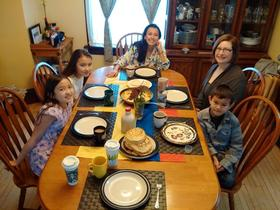 <p>Natalia and her host family, ready to try the Colombian breakfast. Photo: Vinh Huynh.</p>